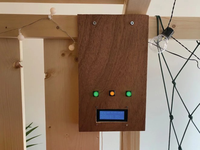The control box uses a simple LCD display for weather and time