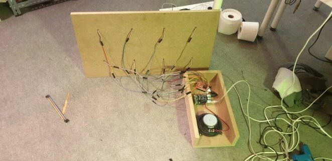 Raspberry Pi, HiFiBerry AMP, and speaker are placed in a wooden box, along with an Arduino Mega connected to the sensors