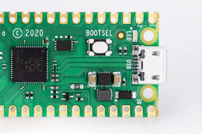 Hold Raspberry Pi Pico's BOOTSEL button while connecting power to put Pico into boot mode