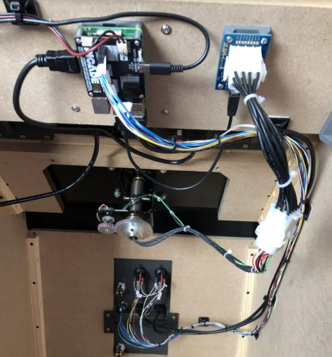 The workings were simple when it came down to it: Raspberry Pi 3B+ with Pimoroni Picade X HAT. This gives us a power switch, audio amp, buttons, and a joystick if necessary. The replica yoke is interfaced with a USB adapter from the same company