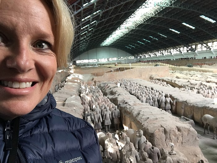 Standing in front of the terracotta warriors
