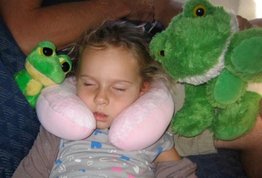 Child asleep on plane