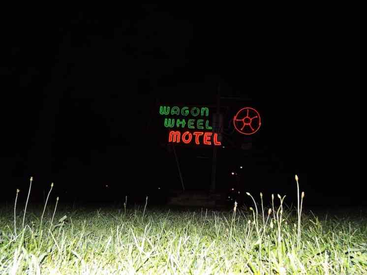 The Wagon Wheel Route 66 Motel neon sign at night