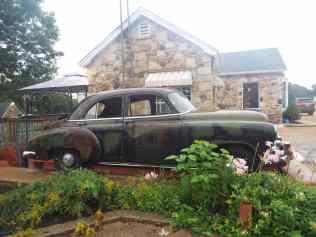 Classic car outside the Wagon Wheel motel in cuba missouri
