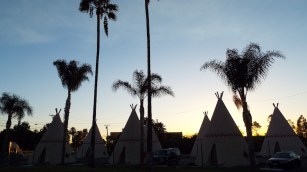 dusk falls at The wigwam Motel