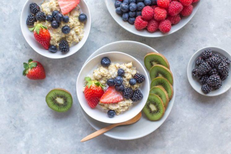 high fiber oatmeal fruit berries in white bowl