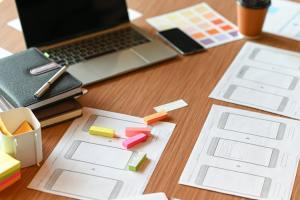 Designer desk space for designers. Color charts, model phones and tablet.