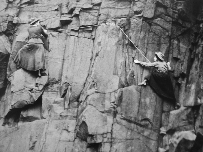 Two women climbing a cliff face in 1908