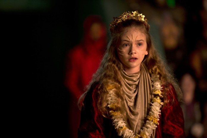 Merry prepares to sing the Long Song in The Rings of Akhaten (c) BBC Studios Doctor Who Series 7 Emilia Jones
