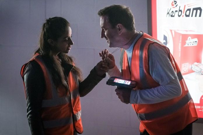 Doctor Who - Series 11 - Episode 7 - Kerblam - Dan Cooper (LEE MACK) shows Yaz (MANDIP GILL) his necklace.