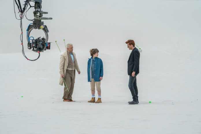 Good Omens - BEHIND THE SCENES. Aziraphale (MICHAEL SHEEN), Adam Young (SAM TAYLOR BUCK), Crowley (DAVID TENNANT) - (C) BBC Studios/Amazon Studios - Photographer: Chris Raphael