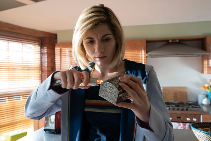 The Doctor (JODIE WHITTAKER) scans a box containing a clue she may not be ready for - (C) BBC - Photographer: Ben Blackall Doctor Who Series 12 Fugitive of the Judoon