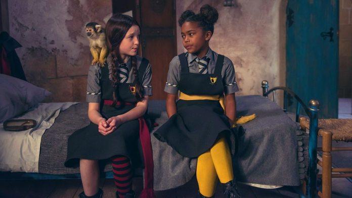 Mildred Hubble (Bella Ramsey) and Enid Nightshade (Tamara Smart) in The Worst Witch (c) CBBC Maxine Alderton