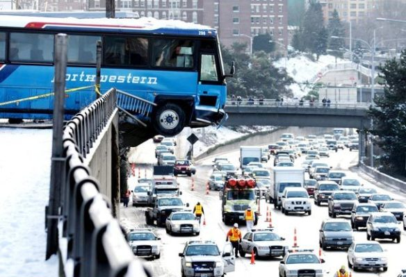 Charter Bus Dangling Over I-5