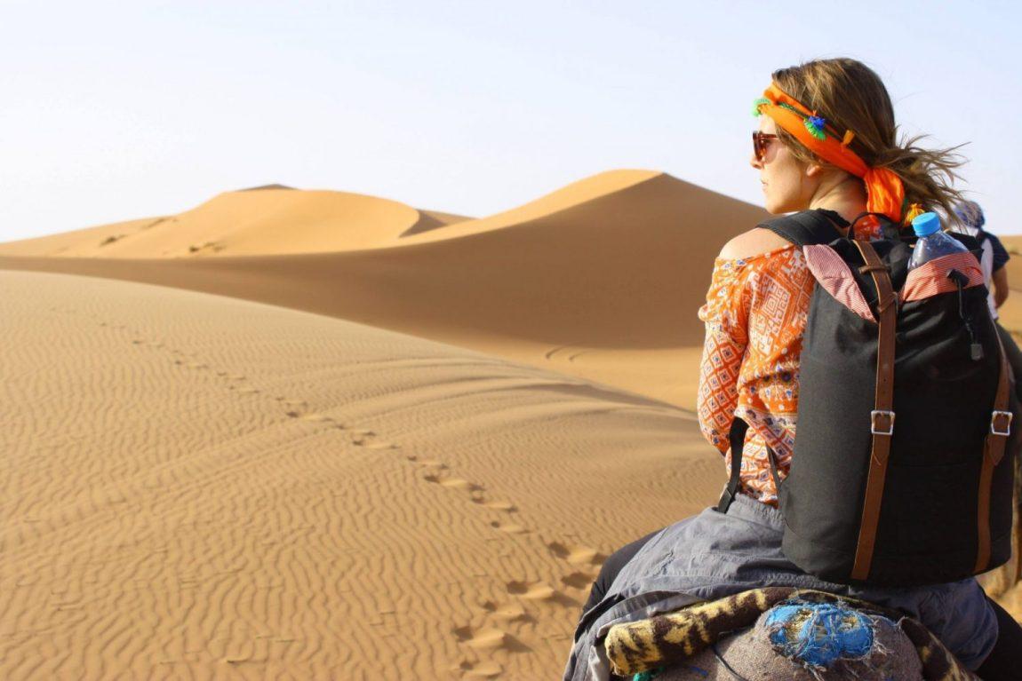 sahara desert backpack camel dunes