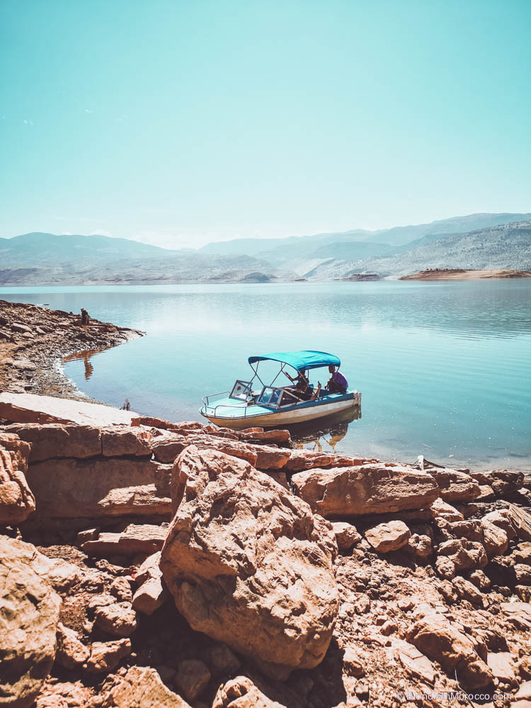 bin el ouidane lake morocco girl view mountains boat