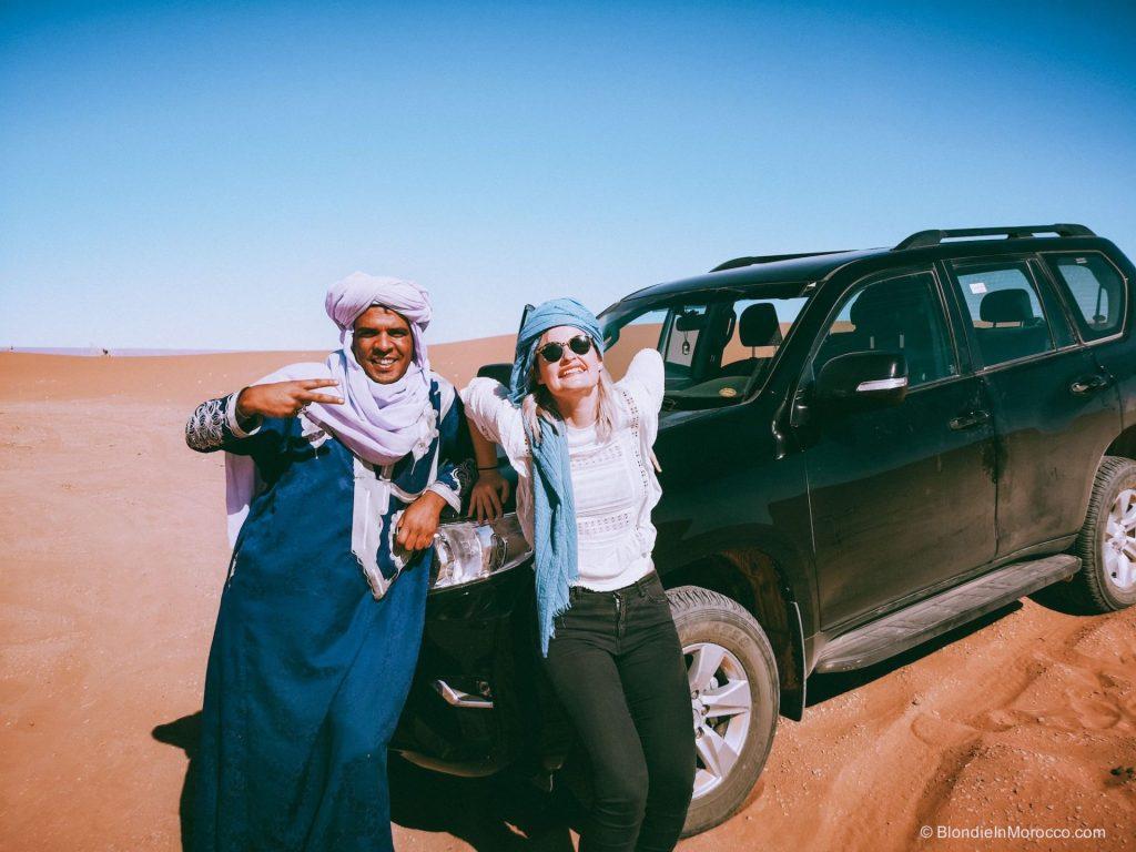 erg chigaga desert morocco dunes sahara driver car nomad