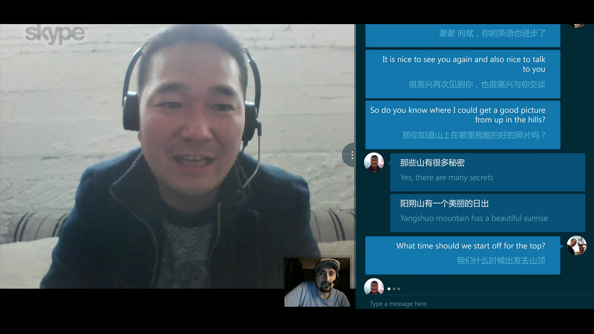 A screenshot of two people talking to each other in different languages through Skype Translator