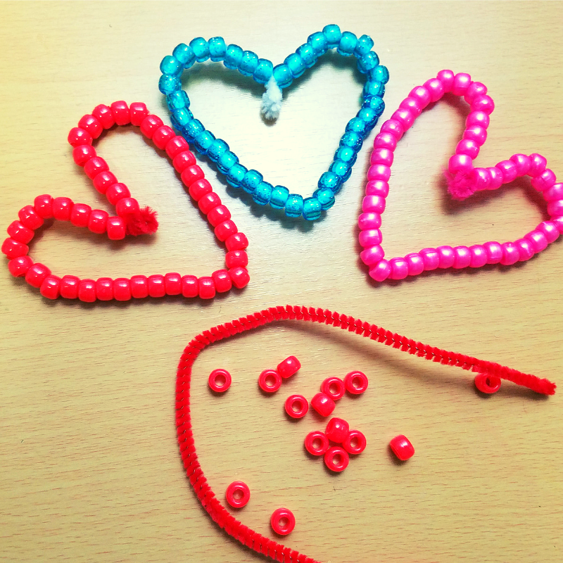 I love this beaded hearts craft because it helps develop fine motor skills and hand strength.