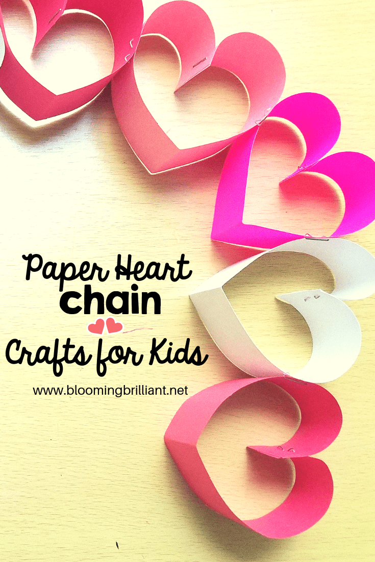 Creating a paper heart chain is super simple and a festive way to get excited for Valentine's Day! #Craftsforkids