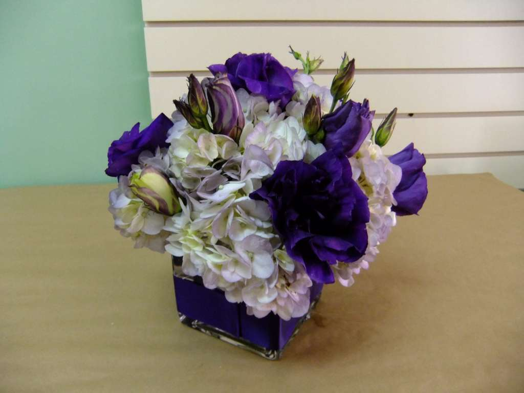 Hydrangea and lisianthus in a 4 in opening container