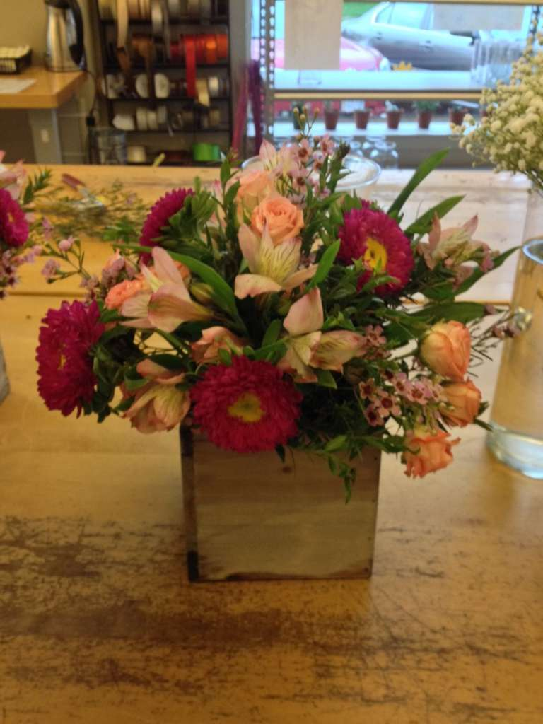 Mixed flower arrangement in 4 to 5 in opening container
