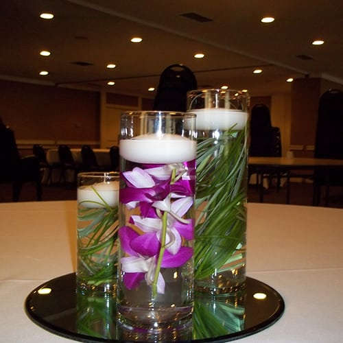 Trio cylinders with grass and orchids