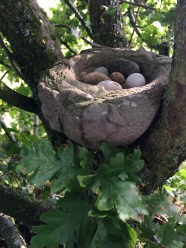 Stone garden sculpture of a nest