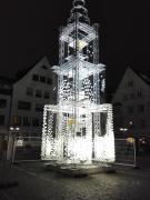 Lichtbaum mit Bildern der Spender für die Restauration des Münsters