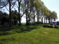Blick aus dem Wohnmobil über die Steilküste hinweg in das Tromper Wiek