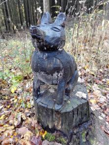 Ein Wölflein sitzt im Walde, ganz still und stumm
