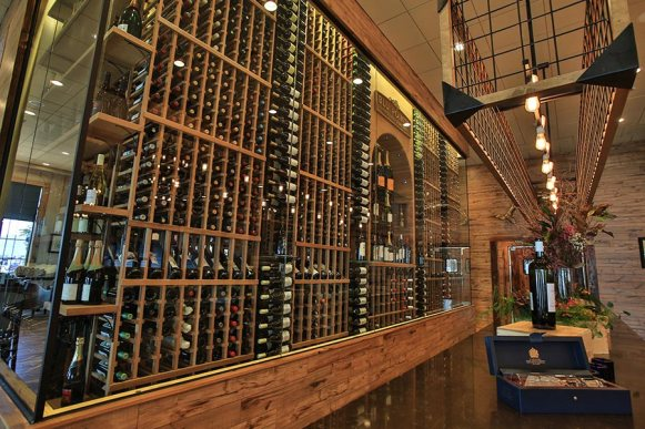 Our walk in wine room can hold up to 3000 new and old world wines