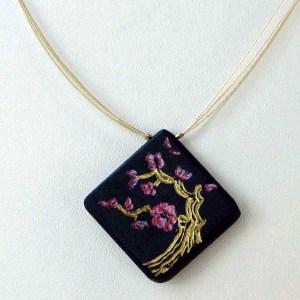 Ebène cerisier en fleurs doré chez Blue Baobab