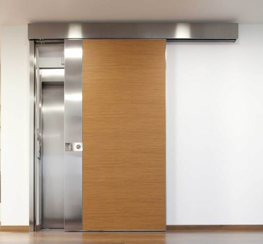 wood clad sliding door for lift access