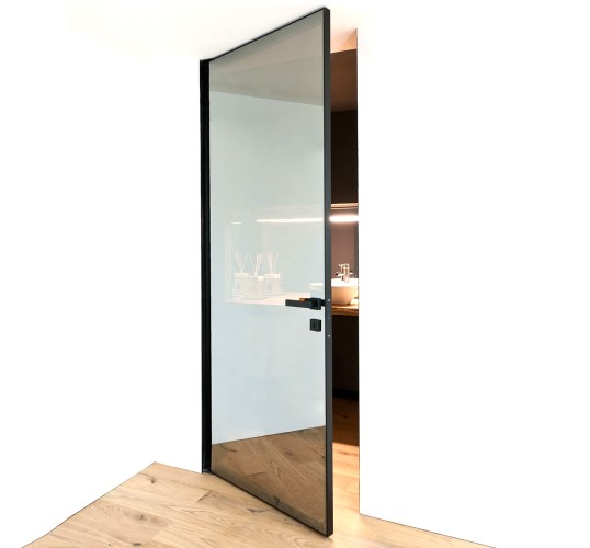 Bluebell Architectural Design Products Albed Doors Quadra Bilico pivot door open with reflex glass