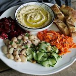 Delicious Salad Platter with Hummus and Baguette