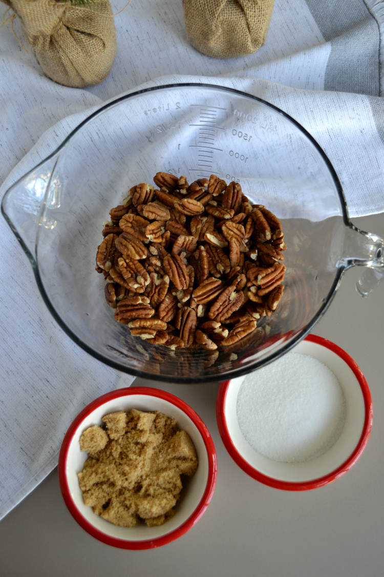 Sweet and Spicy Candied Pecans – a sweet and spicy twist on classic candied pecans that are easy to make and perfect for holiday snacking!