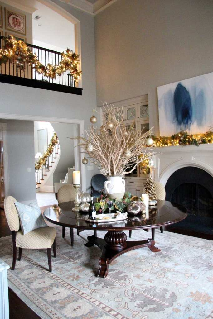 Frontgate Christmas Decor and Frontgate holiday collection in formal dining room with round dining room table.
