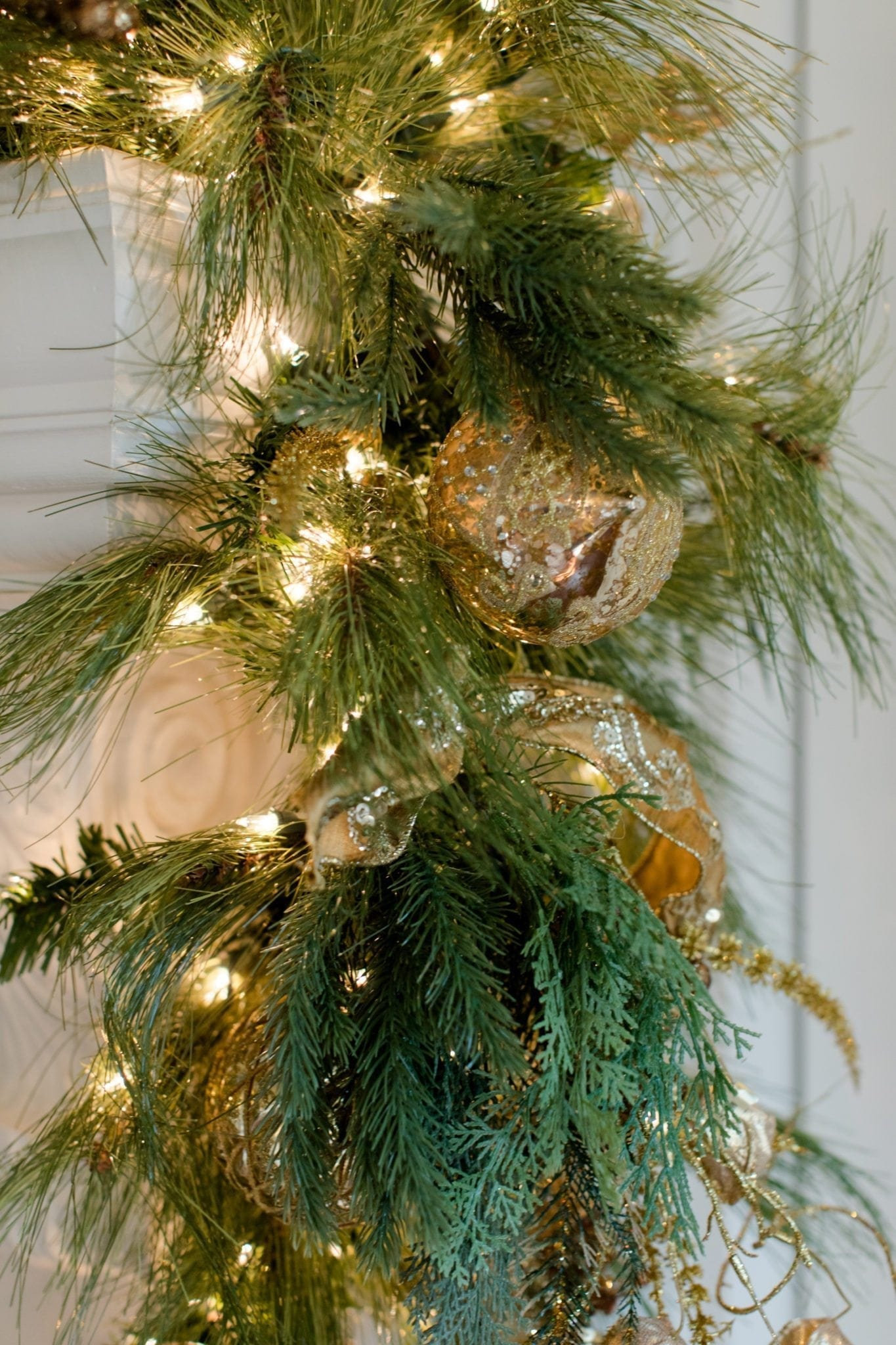 Christmas Garland with Gold Ornaments and Gold Ribbon.