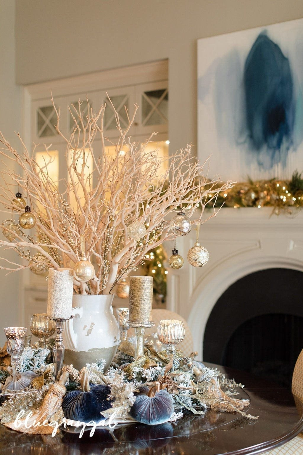 Holiday Centerpiece Decor with manzanita branches and a tuscan urn on a round dining room table