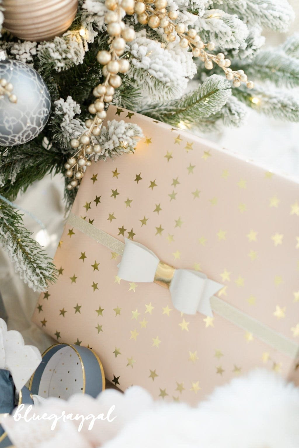 sugar paper white ribbon under blue christmas tree for holiday wrapping paper