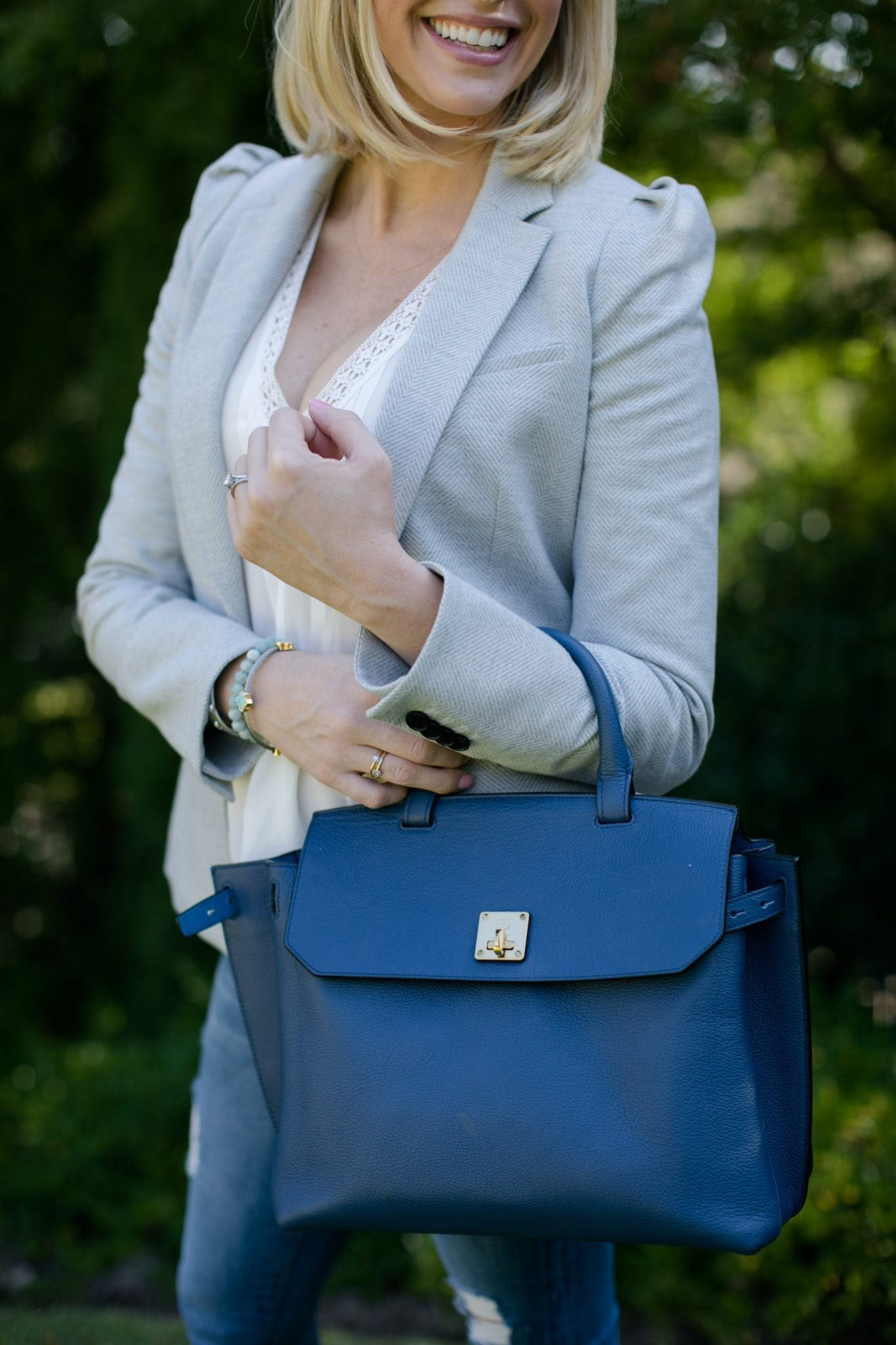bluegraygal in a light blue veronica beard blazer holding a backpack by MCM in blue with white joie shirt on