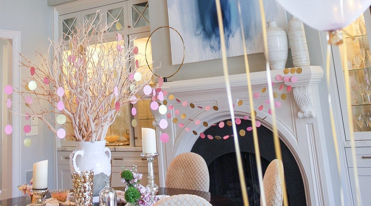 inexpensive baby shower decor with pink garland and centerpiece with pink garland