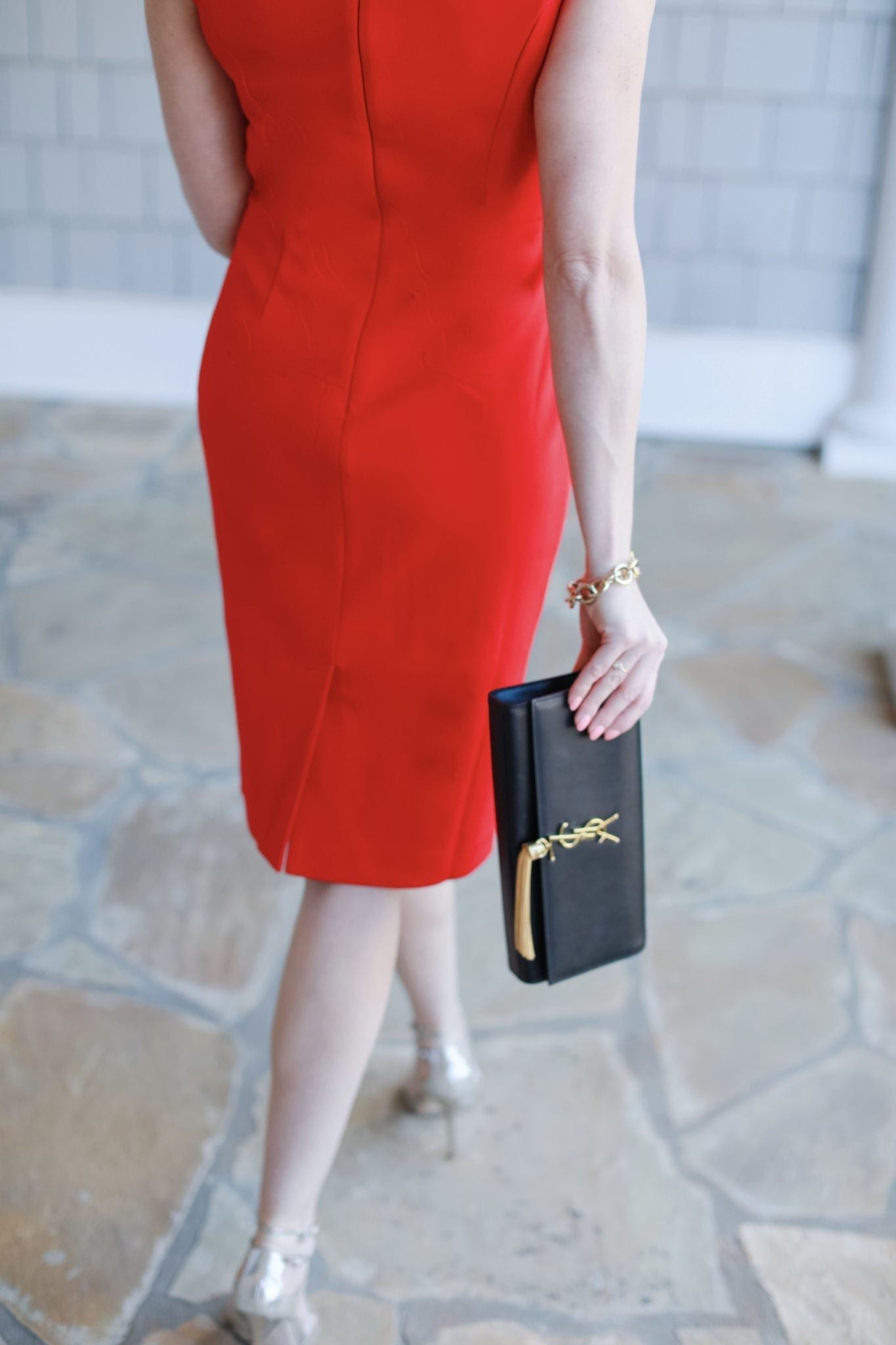 Dresses for cocktail parties. Red dress and black YSL clutch.