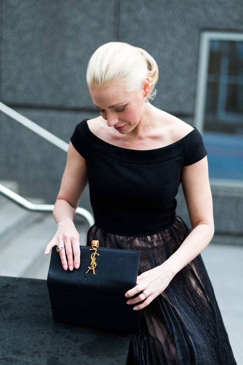 YSL clutch with tassel. Black and nude long gown.