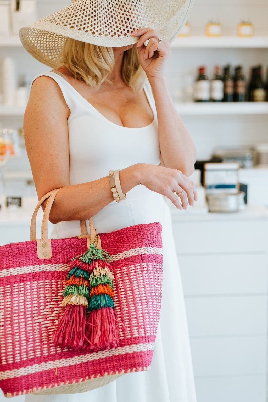 Little White dress for summer. Perfect beach dress with pink straw handbag with straw tassels. Add a pop of pink to an all white outfit!