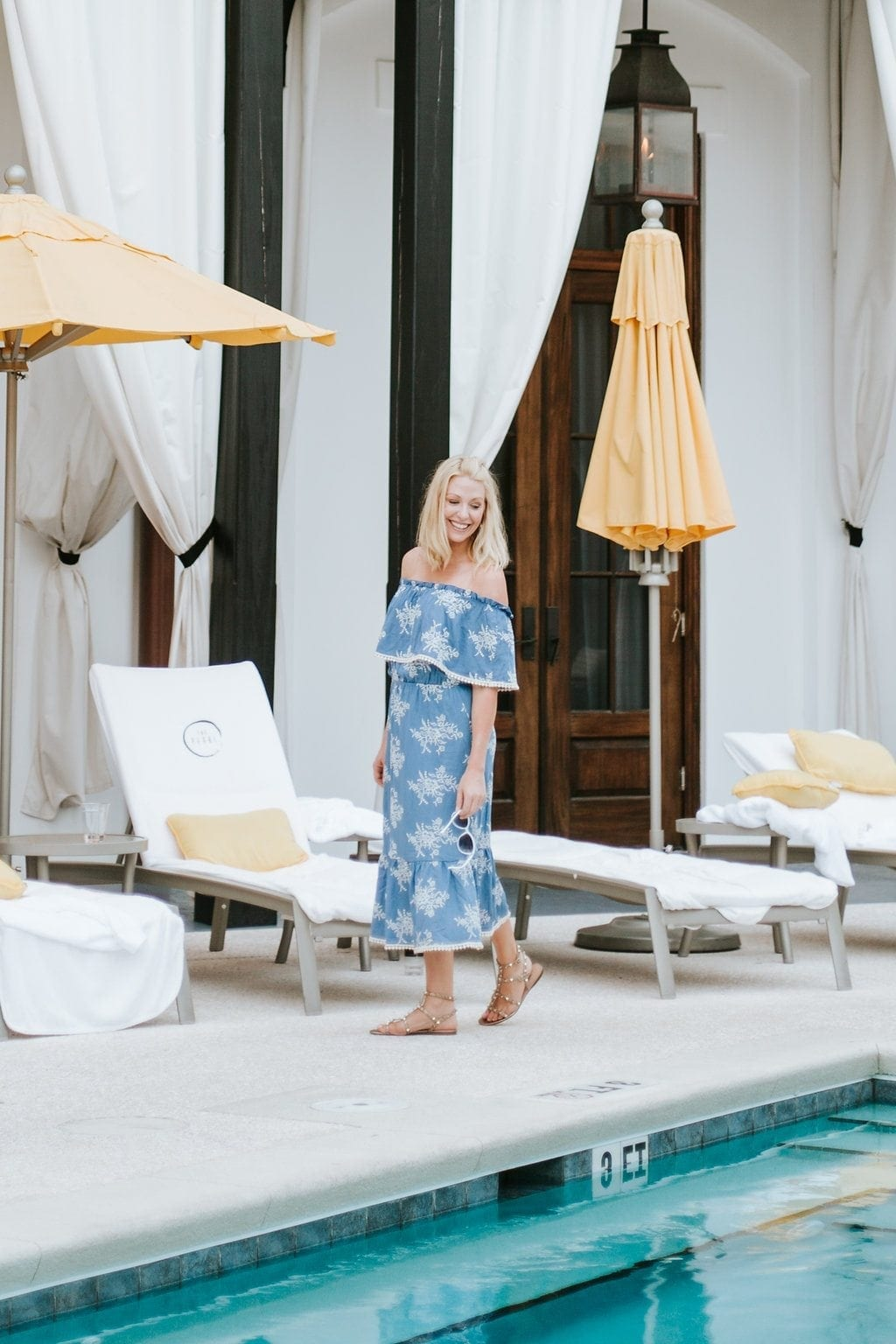 Rosemary Beach pool and Kelly Page in blue midi dress.