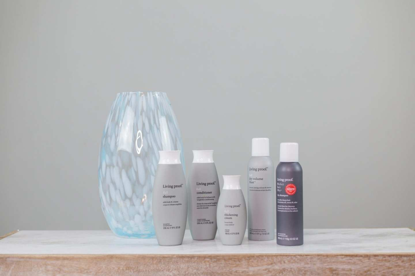 Living Proof hair care line. This is a great shampoo to create volume for people with straight hair. Add volume to straight hair with these products from Living Proof. My hair doesn't usually do anything, but this hair care line has given me lift and volume easily! I use them in this top knot tutorial.