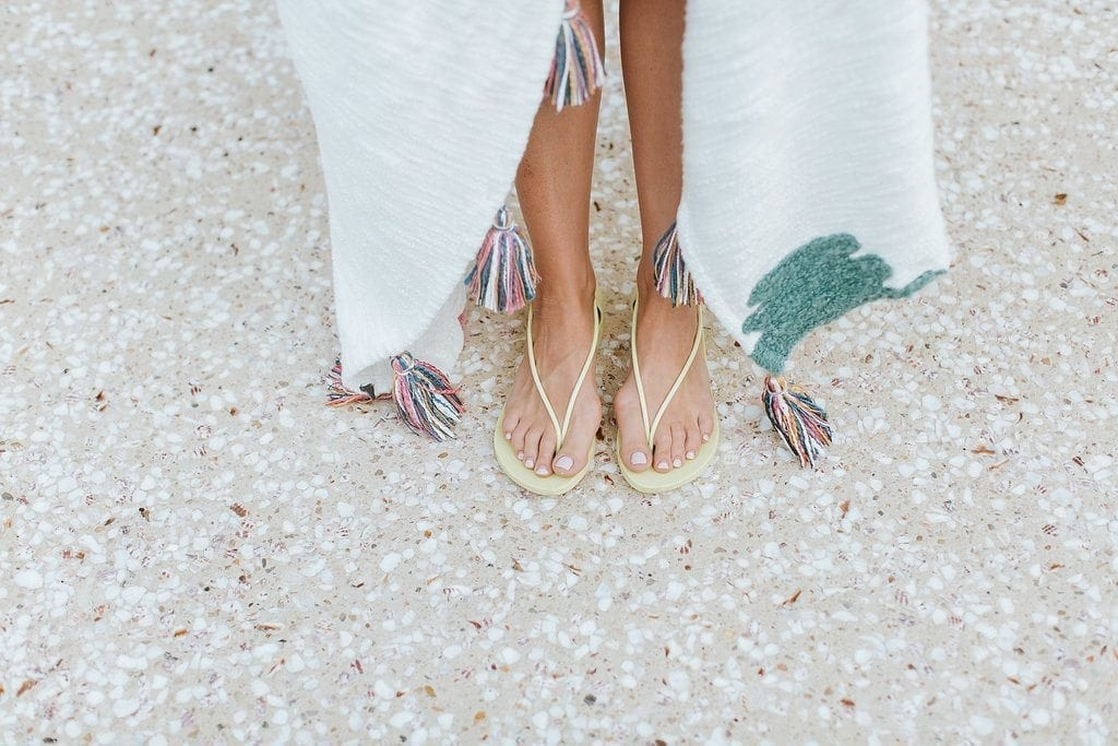 Yellow sandals and tassel blanket from Anthropologie.