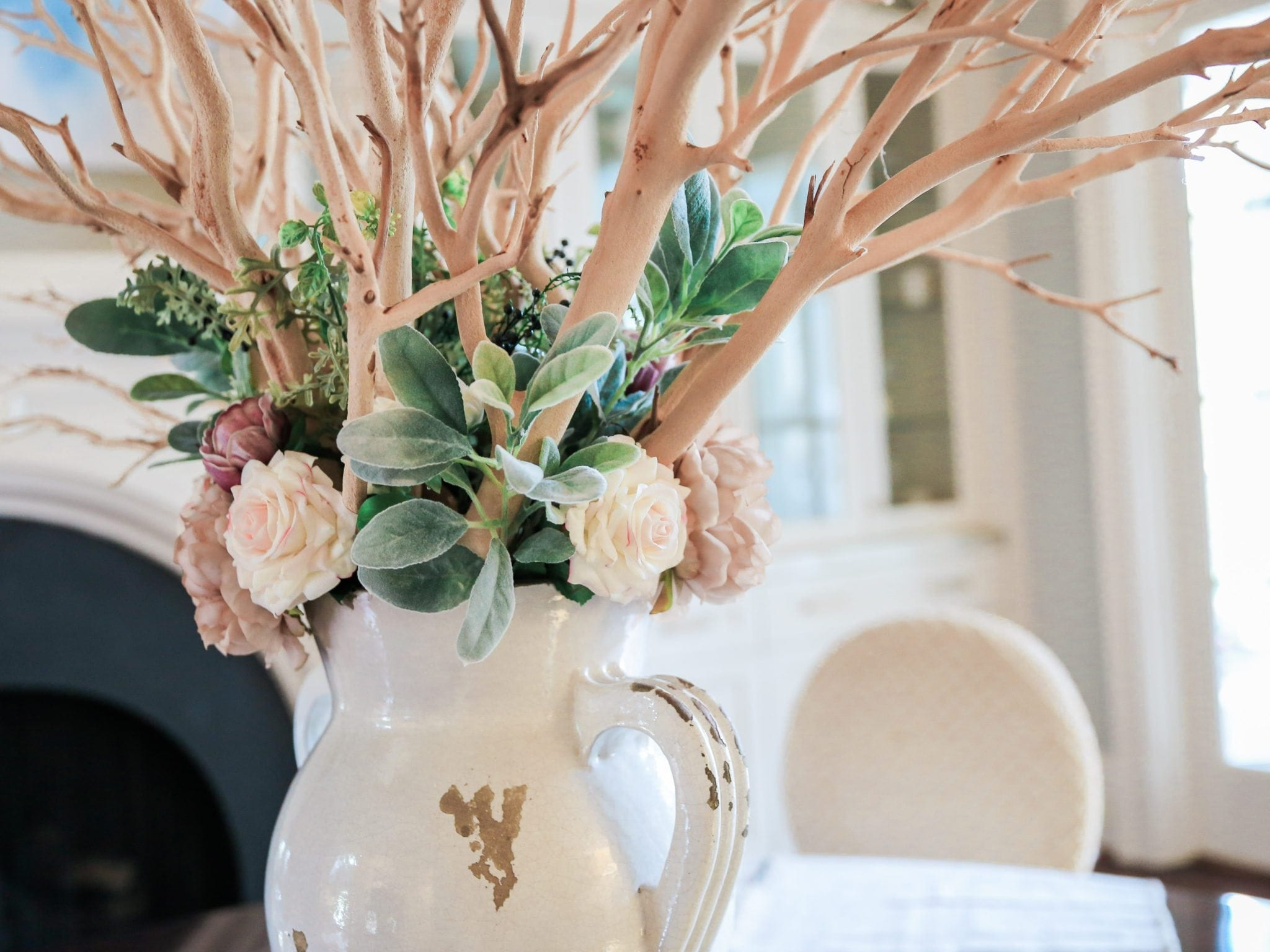 Atlanta blogger - lifestyle blogger creating home centerpiece inspiration with manzanita branches in dining room.